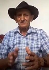 Pedro Carneiro de Oliveira, o Pedro de Elias, 81, guarda na memória, versos do canto da bandeira. Reprodução do zoom